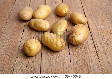 Freshly organic potatoes on a wooden background