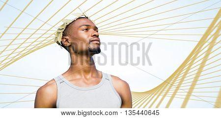 Portrait of victorious sportsman against blue angular design