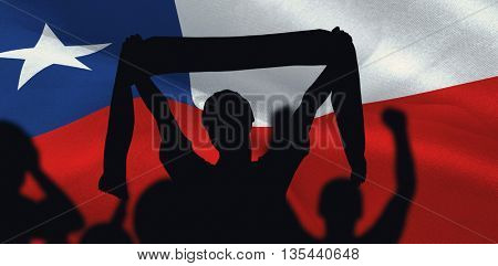 Silhouettes of football supporters against digitally generated chile national flag