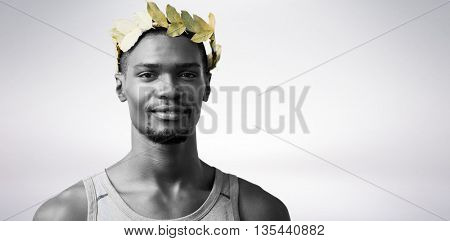 Portrait of victorious sportsman with crown of laurels against blue wave