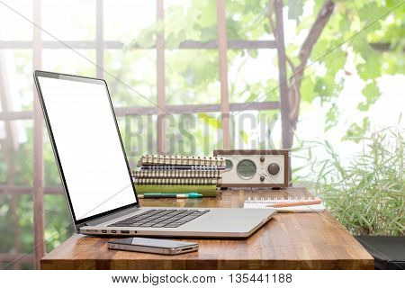 blank screen laptop and smart phone on wooden worktable