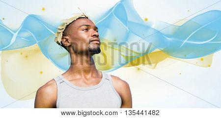Portrait of victorious sportsman against blue wave