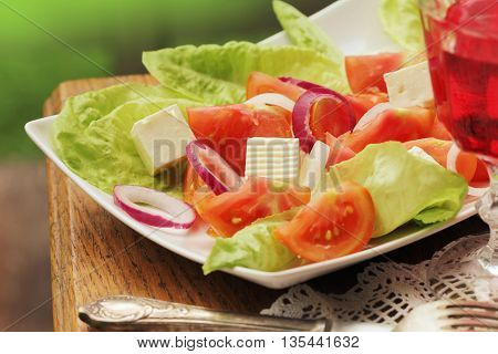 salad with lettuce, goat cheese and tomato