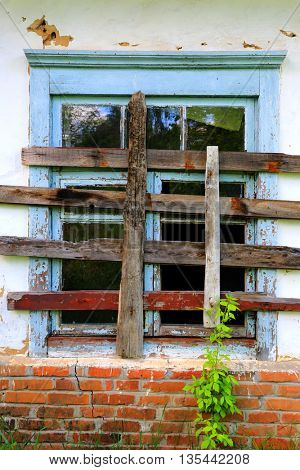 Abstract window of old broken house