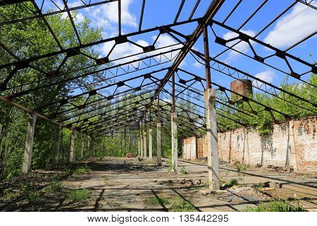 abandoned and destroyed hangar in sunny day