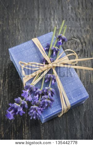 Lavender handmade artisan soap with fresh flowers on rustic wooden background