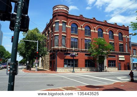 JOLIET, ILLINOIS / UNITED STATES - JUNE 3, 2015: An historic red brick building sits vacant in downtown Joliet.