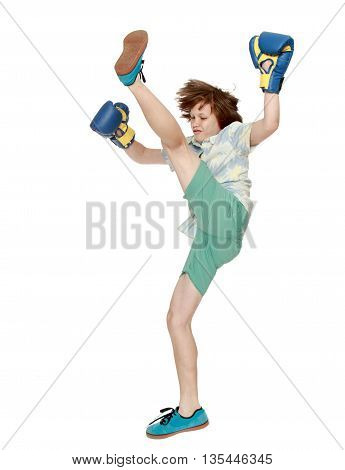 Young man in Boxing gloves shows kick-Isolated on white background