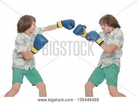 A collage of two photos where there is one person. Two identical young men in gloves-Boxing among themselves. Close-up-Isolated on white background