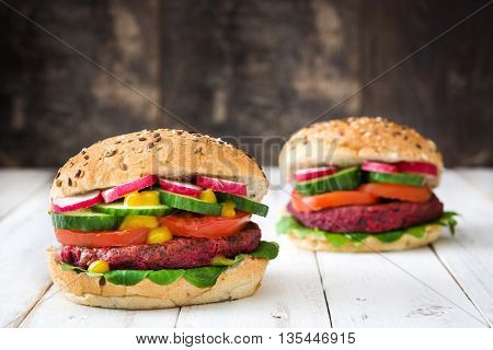 Veggie beet burgers on white wooden table