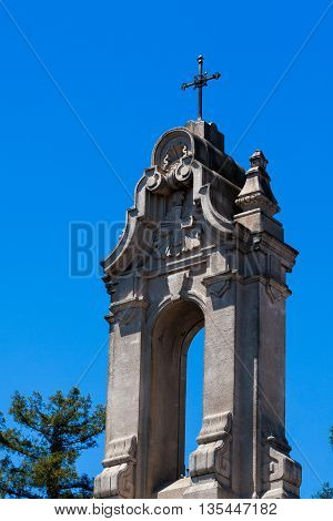 Cross on top of the Saint Rose Parish with clear blue skies in the background in Santa Rosa California.