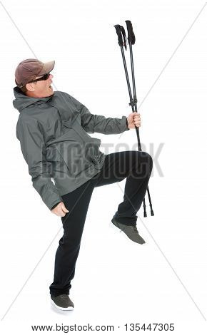 50 year old man in a tracksuit waving his Nordic walking sticks-Isolated on white background