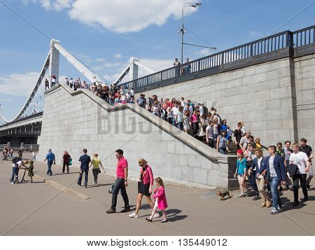 Moscow - May 9 2016: A lot of people down the stairs of the Crimean bridge to visit and relax in the Gorky Park May 9 2016 Moscow Russia