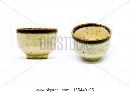 Small cup or sake cup print pattern color yellow and brown.
