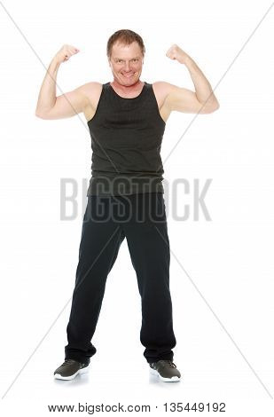 A 50 year old man does morning exercises-Isolated on white background