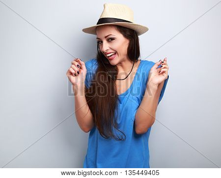 Happy Giggling Young Woman With Straw Hat On Blue Background Looking In Camera