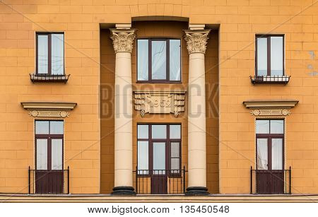 St. Petersburg Russia - May 16 2016: Several windows in a row and balconies on facade of urban apartment building front view