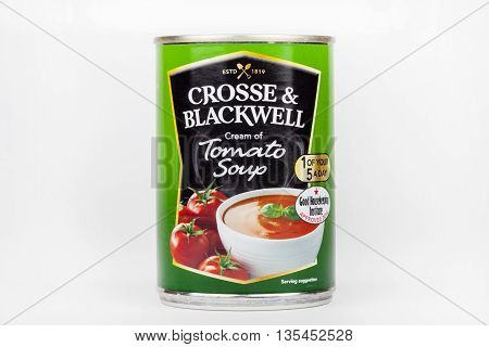 LONDON UK - JUNE 16TH 2016: A tin of Crosse and Blackwell Cream of Tomato Soup pictured over a plain white background on 16th June 2016.