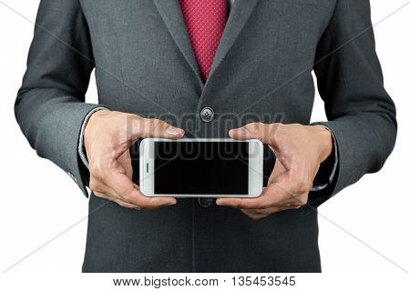Businessman hold blank screen smartphone with both hands with clipping path