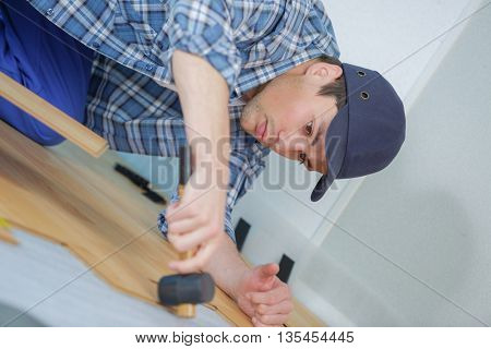 young handyman in uniform