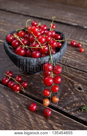 Red currant in ceramic bowl red currants on a brown background red currants