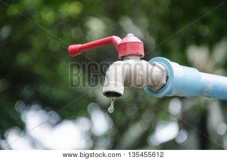 water shortage Old faucet dripping water save water concept on Earth day