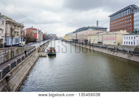MOSCOW, RUSSIA - APRIL 4, 2015: Ozerkovskaya naberezhnaya and Bypass Canal in downtown Moscow, Russia. Blending of new and historic architecture