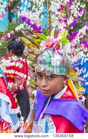 PANCHIMALCO EL SALVADOR - MAY 08 : Salvadoran boy participate in the procession of the Flower & Palm Festival in Panchimalco El Salvador on May 08 2016