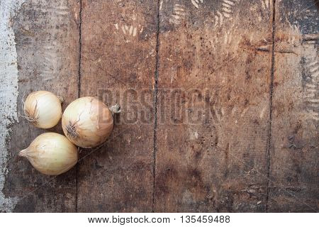 Ripe Onions On A Wooden Background,top View