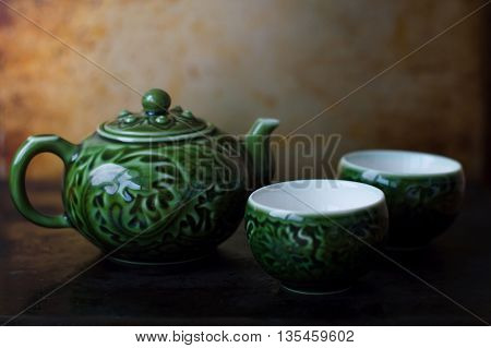 Chinese tea pot and two bowls for traditional chinese tea ceremony