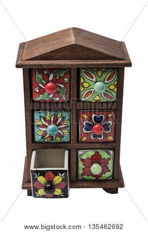Small decorative stylish colorful printed oriental cupboard with foots with ceramic shelves with one opened shelf on isolated background