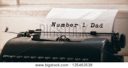 Number 1 dad message against typewriter on a table