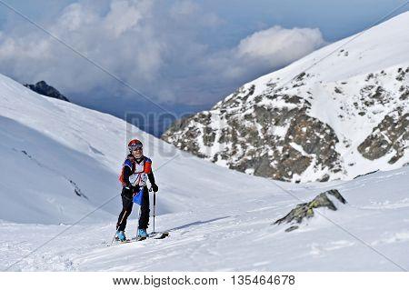FAGARAS ROMANIA - MARCH 5: Ski mountaineer competes during the Ski Mountaineering National Competition in Fagaras Mountains Carpathian Range on March 5 2016 in Romania.