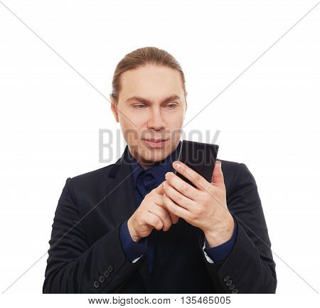 Stylish serious man portrait with smart phone, mobile or cell. Fashionable long-haired guy in suit with dark blue shirt touch screen, isolated at white background. Male portrait with device
