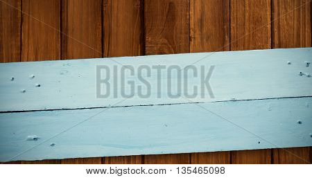 Painted blue wooden planks against wooden planks