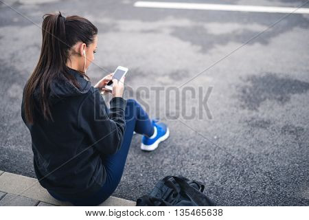 Young girl resting after a heavy workout.