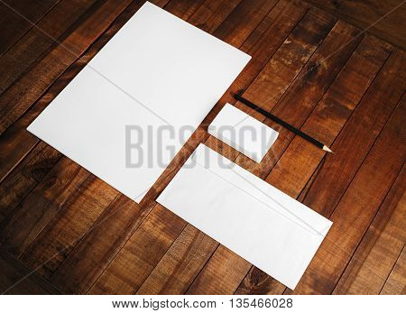 Photo of blank stationery set. Blank corporate identity template on wooden table background. Mock-up for design presentations and portfolios.