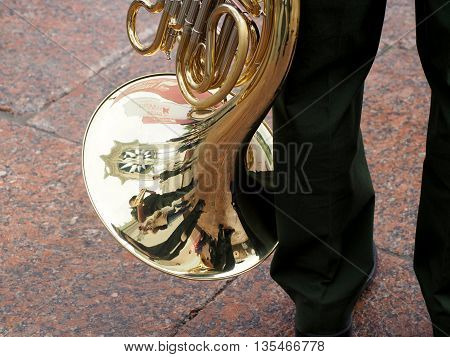 MOSCOW, RUSSIA - JUNE 4, 2016: Horn player before the performance. Military brass band playing on the Central Avenue in the Park of VDNH. International Military Music Festival