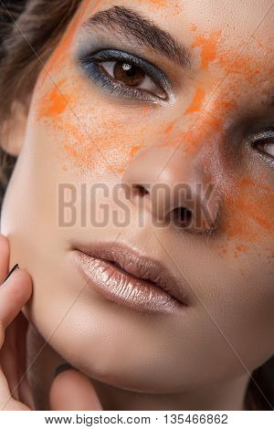 Close Up Of Woman Face With Paint Drops On Face