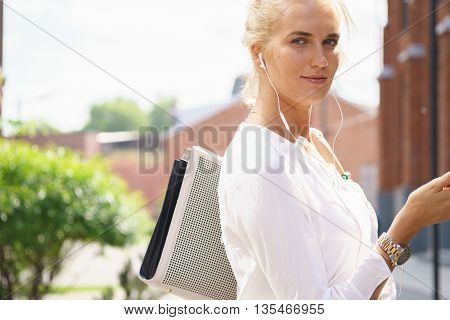 Outdoor street portrait of a smiling business woman
