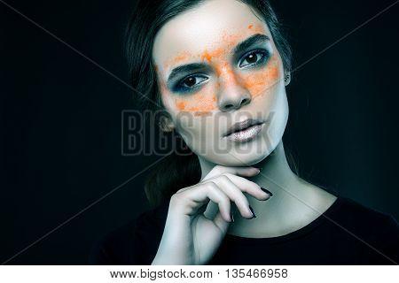 Beauty brunette beautiful girl on grey background.
