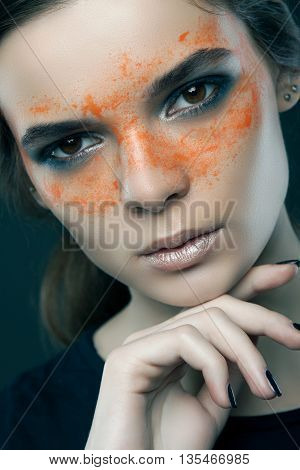 Woman With Paint On His Face. Beauty Photography. Close-up Portrait On Gray Background.