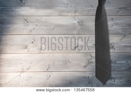 Blue tie against bleached wooden planks background