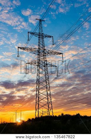 Silhouette pylons against the background of a beautiful sunset.
