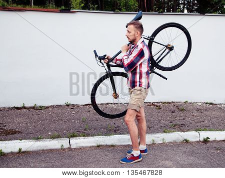Young Hipster Man Holding His Bike