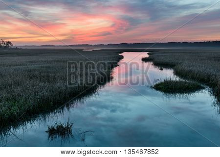 Colorful Sunrise Over Inlet with Water Reflections