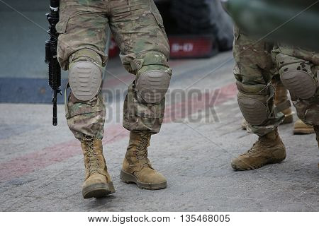 Legs Of Soldiers In Camouflage