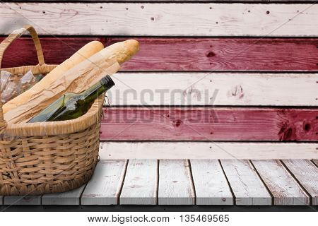 Picnic of wine and baguettes against composite image of usa national flag