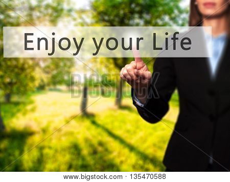 Enjoy Your Life - Businesswoman Hand Pressing Button On Touch Screen Interface.