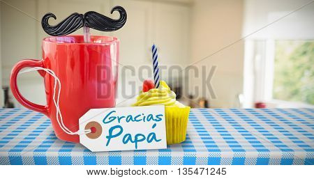 Word gracias papa against delicious cupcake on a table